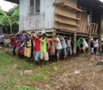 A group of men doing a bayanihan