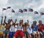 Children wave the Philippine flags