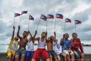 Children wave the Philippine flags