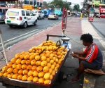 Vendor Selling Mangoes, Quezon City