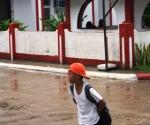 A Boy Walking Under the Rain