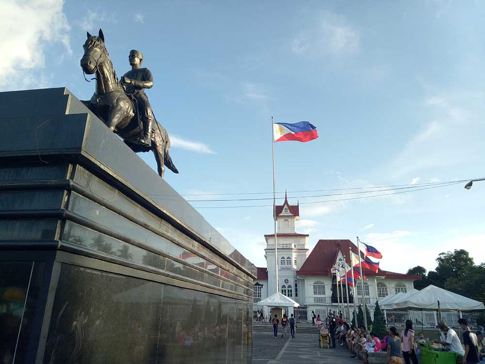 Visitors wait outside the Aguinaldo Shrine in Kawit, Cavite